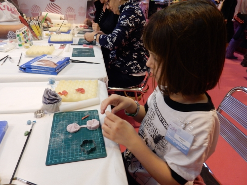 Peo making cupcake.