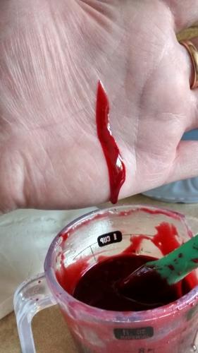fake blood on hand