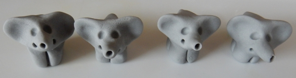 four elephants being made