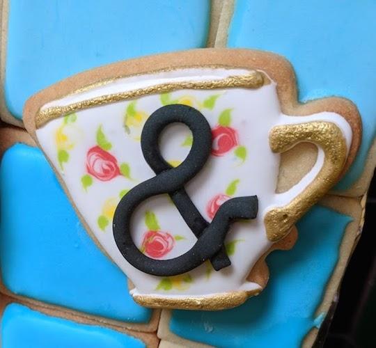 tea cup ampersand